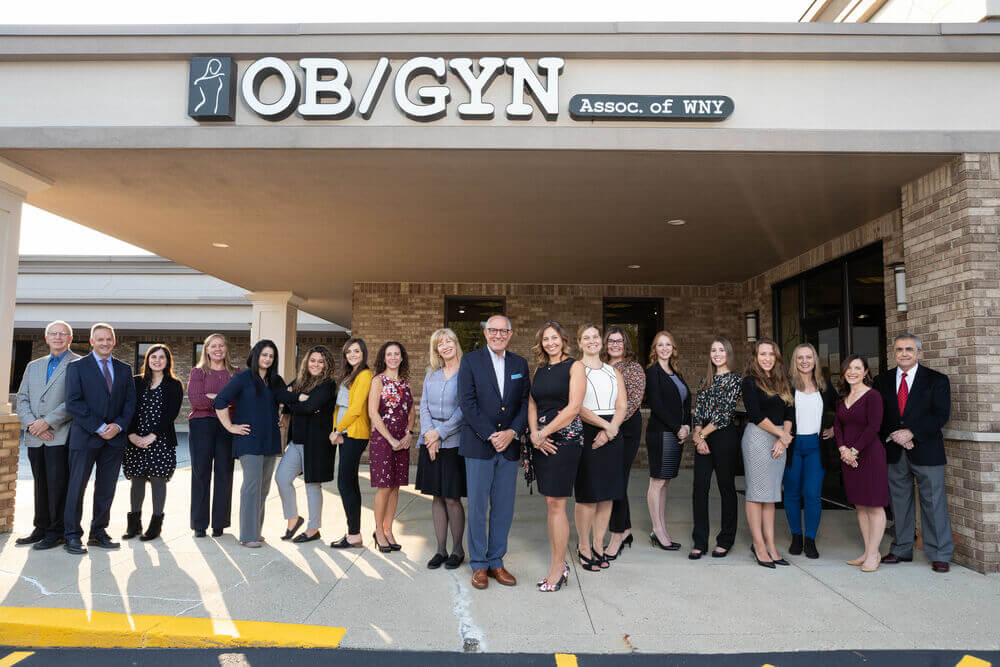 A group shot of the OBGYN WNY staff in front of their office